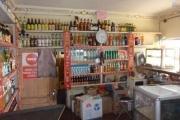 A vendre Hotel / Restaurant  / bar / Karaoké /épicerie avec le mur  sis au by pass - epicerie